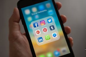 Social media icons shown on a cell phone